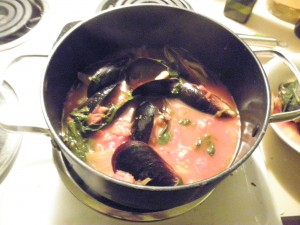 saucepan of mussels in tomato broth