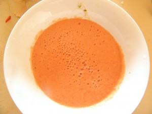 orange soup in bowl