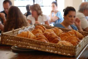 basket of croissants and people in the background