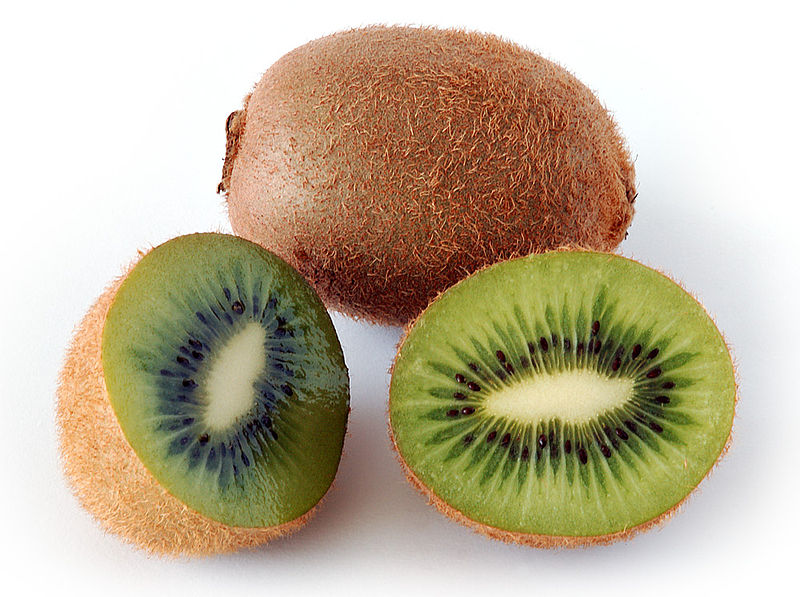 cut and whole kiwi fruits