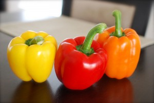 yellow red and orange capsicum (bell peppers)