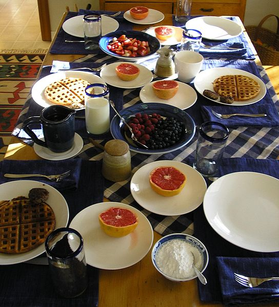 family breakfast of fruit and waffles in America
