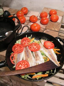fish and tomatoes in fry pan