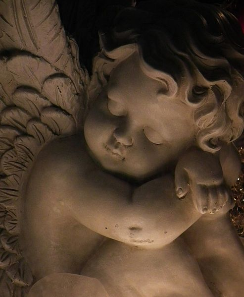 cherub angel sculpture sleeping