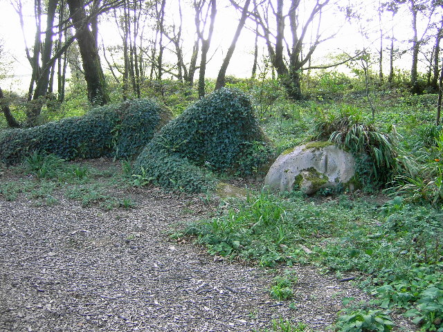 sleeping statue covered with grass
