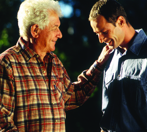older man and younger man talking