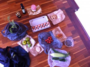 olive oil, boysenberry jam, tomato chutney, fennel plant, eggs, etc all layed out on floor