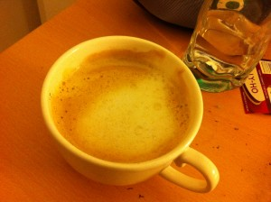 cup of flat white oat milk coffee