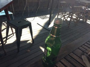 Cafe chair legs and sunshine and cascade apple juice bottle