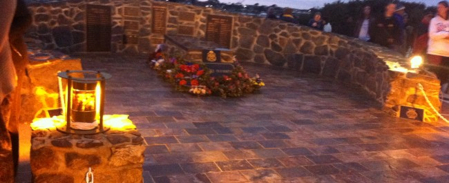 flowers, lamps, headstones and war memorial