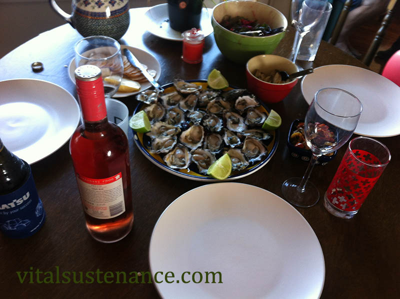 table laid with wine and oysters - alcohol free days