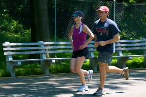 two people jogging in the park