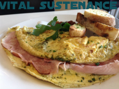 ham and egg omelette with pesto and tomato chutney bread side
