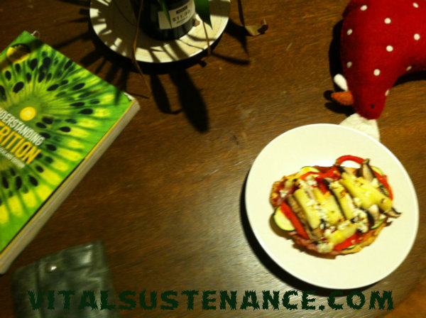 pizza, stuffed toy chicken, nutrition text, plant
