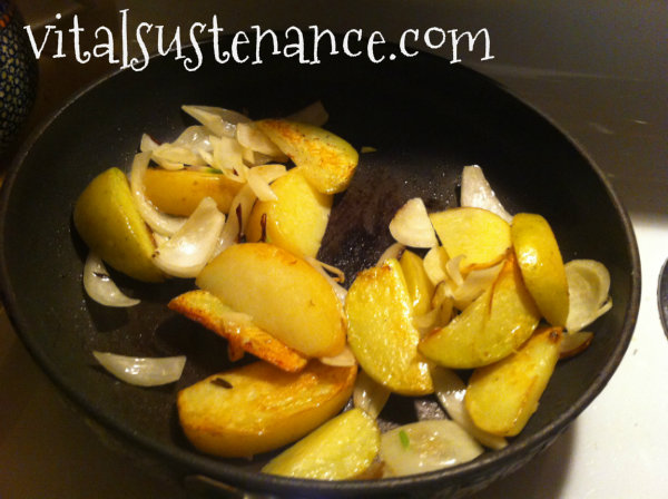 potatoes and onions on fry pan