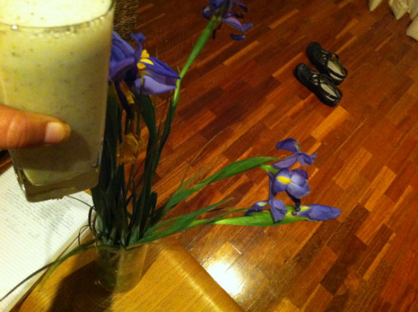glass of calcium smoothie with irises