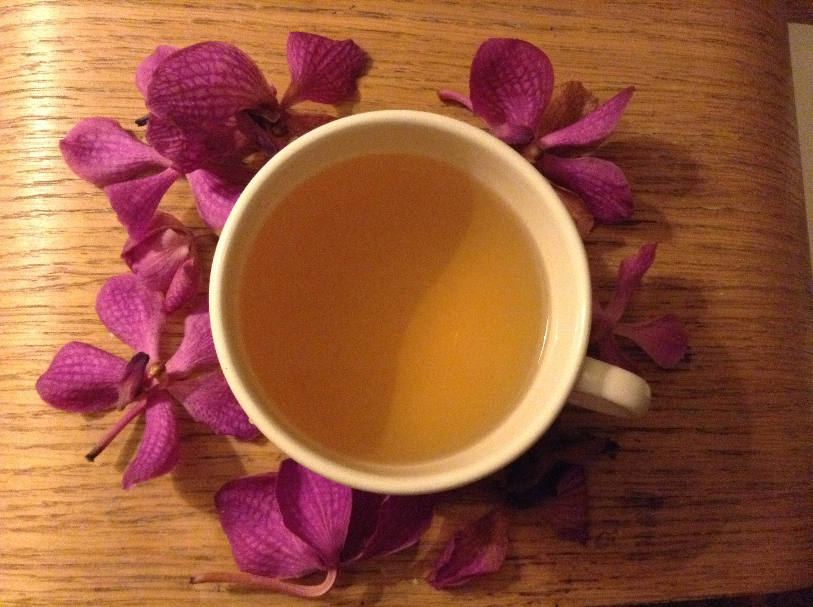 Green chai tea and orchids