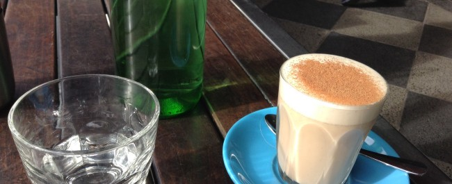 Soy chai and water glass at cafe