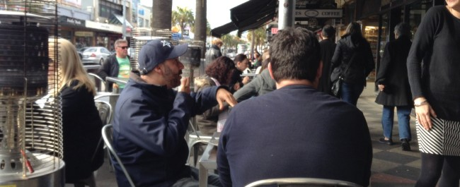 Cafe strip with people outside in St Kilda