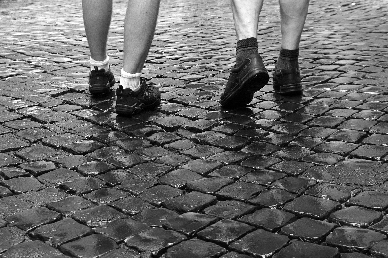 walking 10,000 steps per day for activity requirements - walking on cobblestones in Rome