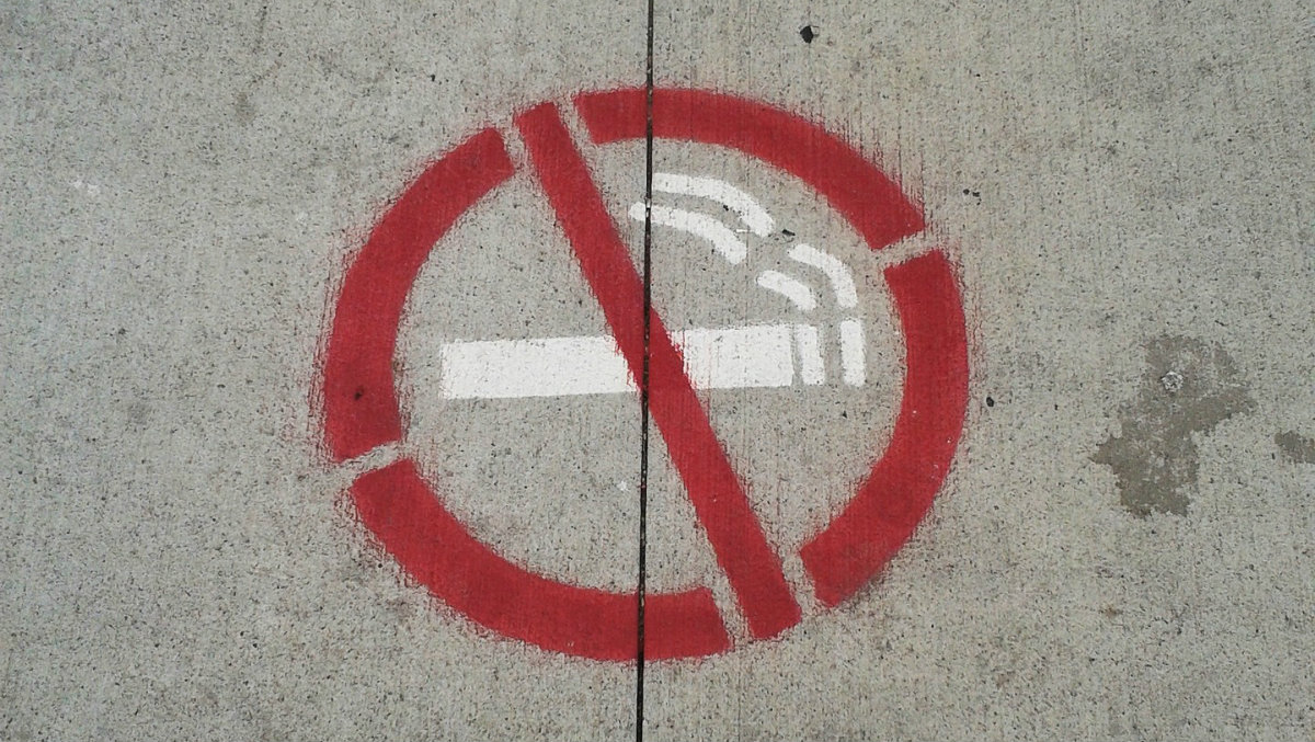 quitting cigarettes with NRT - the sign on concrete