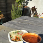 alimentari salad and soup on a rooftop garden in the sun