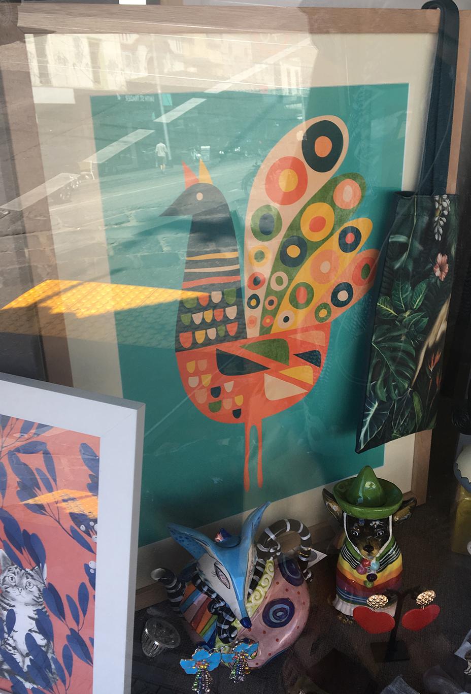 blue, yellow, orange, and green hen print in art shop collingwood