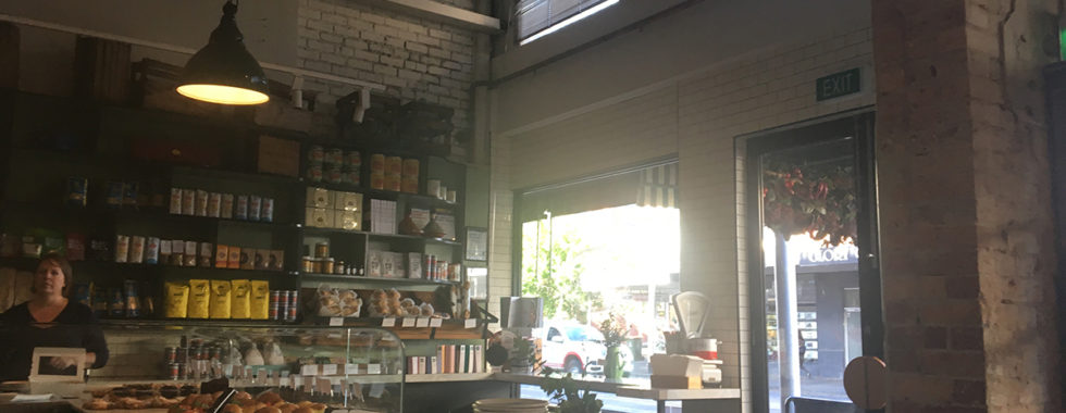 interior of cafe and deli with view across produce and out window
