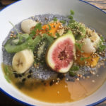chia pudding with figs, mango, banana, kiwi fruit and passionfruit coulis