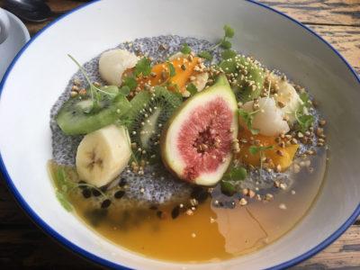 chia pudding with figs, mango, banana, kiwi fruit and passionfruit coulis