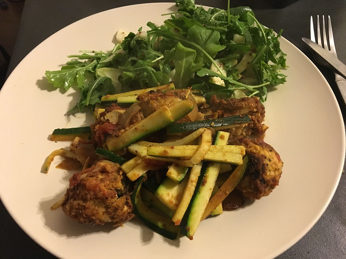 plate of salad, meatballs and zucchini 'pasta' for a low carb vegetarian dinner