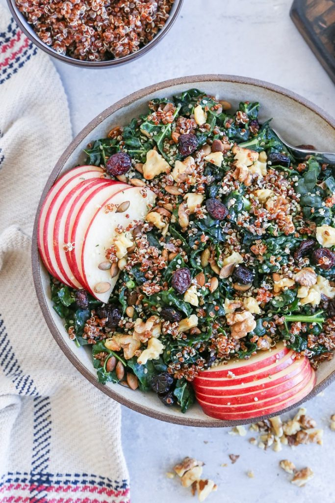 winter vegetarian seasonal recipes - kale and quinoa salad recipe with cranberries, apples and walnuts