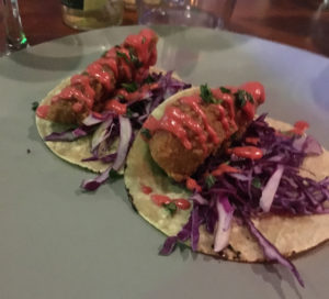 coconut battered fish with red cabbage slaw and beetroot creme